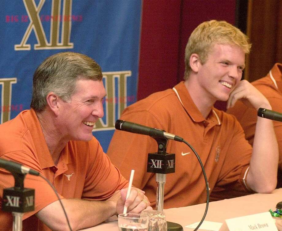 2002 season  Mack Brown shares a laugh with quarterback Chris Simms, right, during an interview session at the Big 12 Conference Football Media Days. The Horns went 11-2 for the second straight season and defeated LSU in the Cotton Bowl. Photo: Richard Carson, Associated Press
