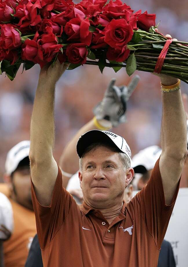 2005 season  Mack Brown holds a bundle of roses after beating Colorado 70-3 in the Big 12 championship game at Reliant Stadium to advance to the national championship game in the Rose Bowl. Photo: David J. Phillip, Associated Press