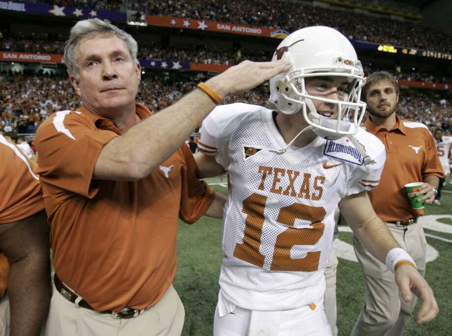 2006 season  Mack Brown, left, and Longhorn quarterback Colt McCoy celebrate the Longhorns' win over Iowa in the Alamo Bowl. Texas finished the season 10-3. Photo: Brett Coomer, Houston Chronicle