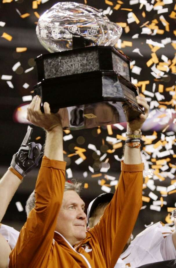 2009 season  Mack Brown lifts the Big 12 championship trophy after his team's 10-6 victory over Nebraska. The Longhorns advanced to the BCS National Championship Game where they lost to Alabama to cap a 13-1 season. Photo: Jamie Squire, Getty Images