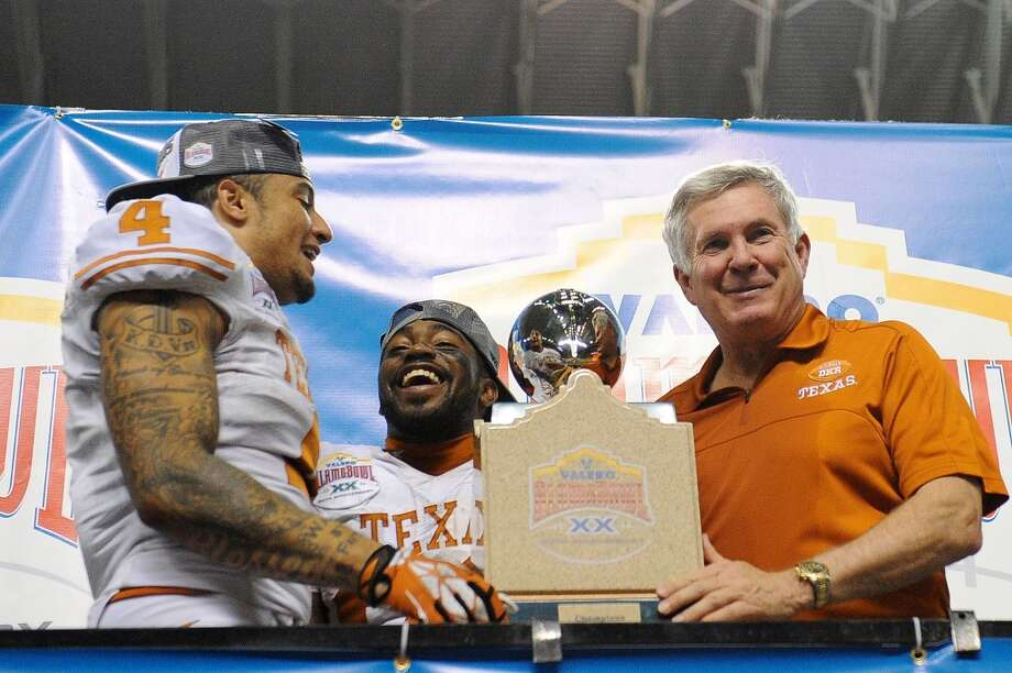 2012 season  Mack Brown and Kenny Vaccaro, right, hold the champion's trophy following the Longhorns' Alamo Bowl win agains against Oregon State. UT finished 9-4. Photo: Stacy Revere, Getty Images