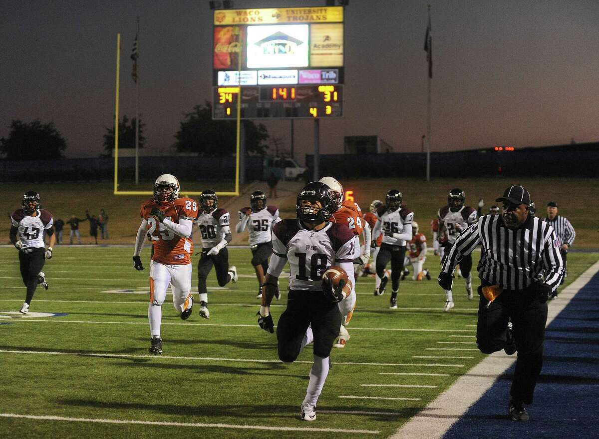 Houston Pearland kick returner Jacoby Lewis (18) returns a kickoff for the winning touchdown as Pearland defeats San Antonio Madison, 38-34, in Class 5A Division I state semifinal game action at Waco ISD Stadium on Saturday, Dec. 14, 2013.
