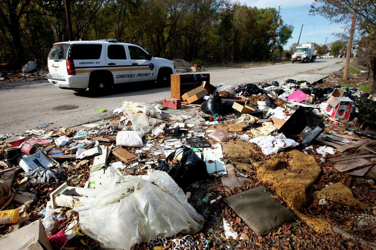 Trash accumulates in the 1400 block of West Street. Illegal dumping of trash has become a urgent problem in Houston.