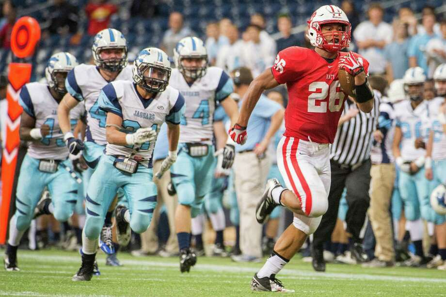 Katy running back Rodney Anderson (26) leaves the Johnson defense in his wake on a 77-yard touchdown run during the first half of a Class 5A state semifinal high school football playoff game at Reliant Stadium on Saturday, Dec. 14, 2013, in Houston. Photo: Smiley N. Pool, Houston Chronicle / © 2013  Houston Chronicle