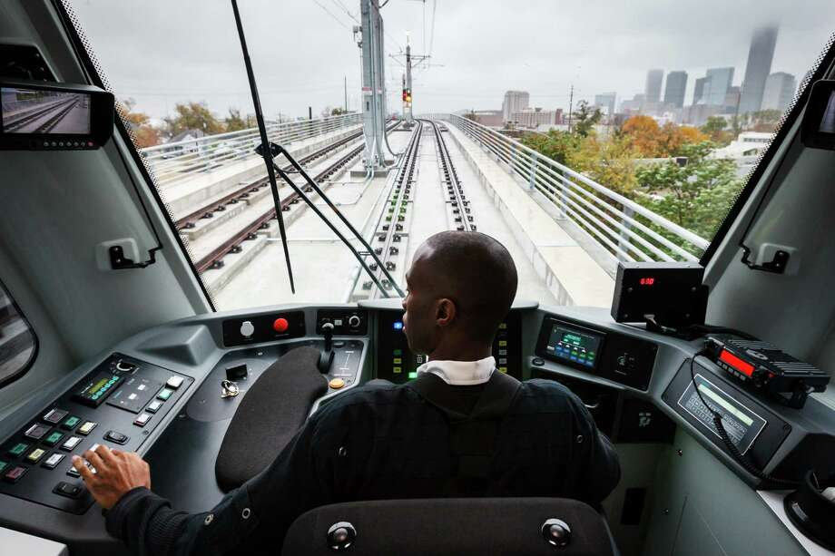 Train operator Terald Riggins has a front-row seat for MetroRail's soon-to-open North/Red Line, a 5.3-mile light rail extension from UH-Downtown Station north to Northline TC/HCC.  ( Michael Paulsen / Houston Chronicle ) Photo: Michael Paulsen, Staff / © 2013 Houston Chronicle