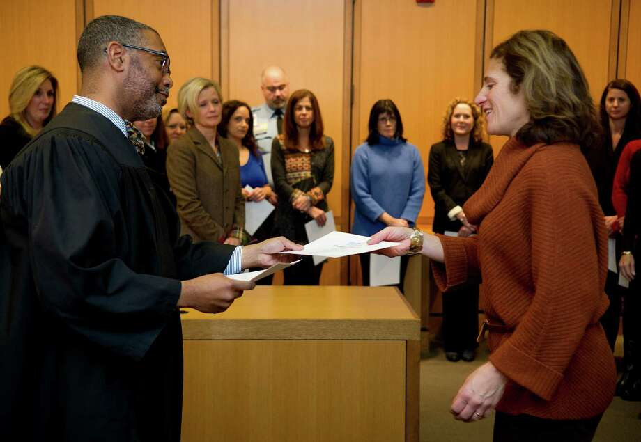 Laura More, of Greenwich, gets a certificate from Judge Kevin Randolph as she is sworn in as a volunteer with Child Advocates of SW Connecticut at State Superior Court in Stamford on Thursday. Photo: Lindsay Perry / Stamford Advocate
