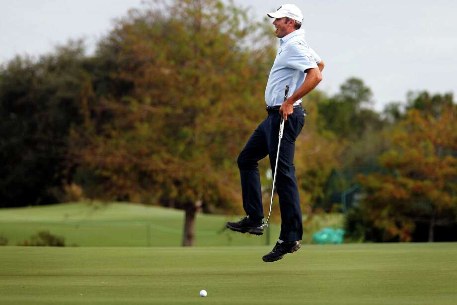 Matt Kuchar may be jumping, but it isn't for joy after a missed putt on the 18th hole Saturday at the Franklin Templeton Shootout in Naples, Fla. The day ended pretty well for Kuchar and teammate Harris English, as they held a four-shot lead. Photo: Dania Maxwell, MBR / Naples Daily News