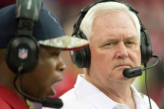 Houston Texans defensive coordinator Wade Phillips watches from the sidelines during the first half of an NFL football game at University of Phoenix Stadium on Sunday, Nov. 10, 2013, in Glendale, Ariz. Phillips will guide the Texans as interim head coach while Gary Kubiak recovers after he suffered a mini-stroke last week. ( Smiley N. Pool / Houston Chronicle )