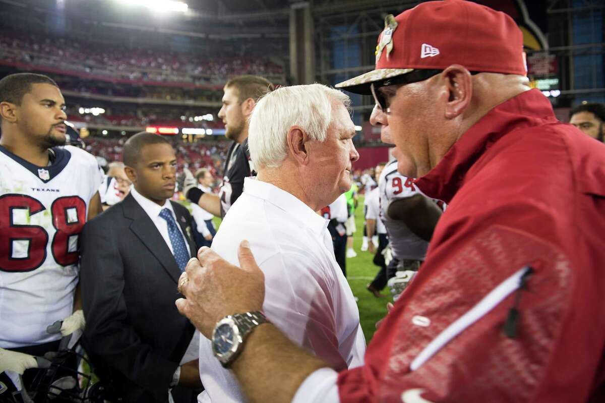 Wade Phillips, center, and Cardinals coach Bruce Arians disprove 60s is a time for retirement.