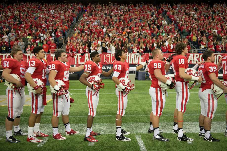 Katy players line up for the national anthem before facing San Antonio Johnson in a Class 5A state semifinal high school football playoff game at Reliant Stadium on Saturday, Dec. 14, 2013, in Houston. Photo: Smiley N. Pool, Houston Chronicle / © 2013  Houston Chronicle