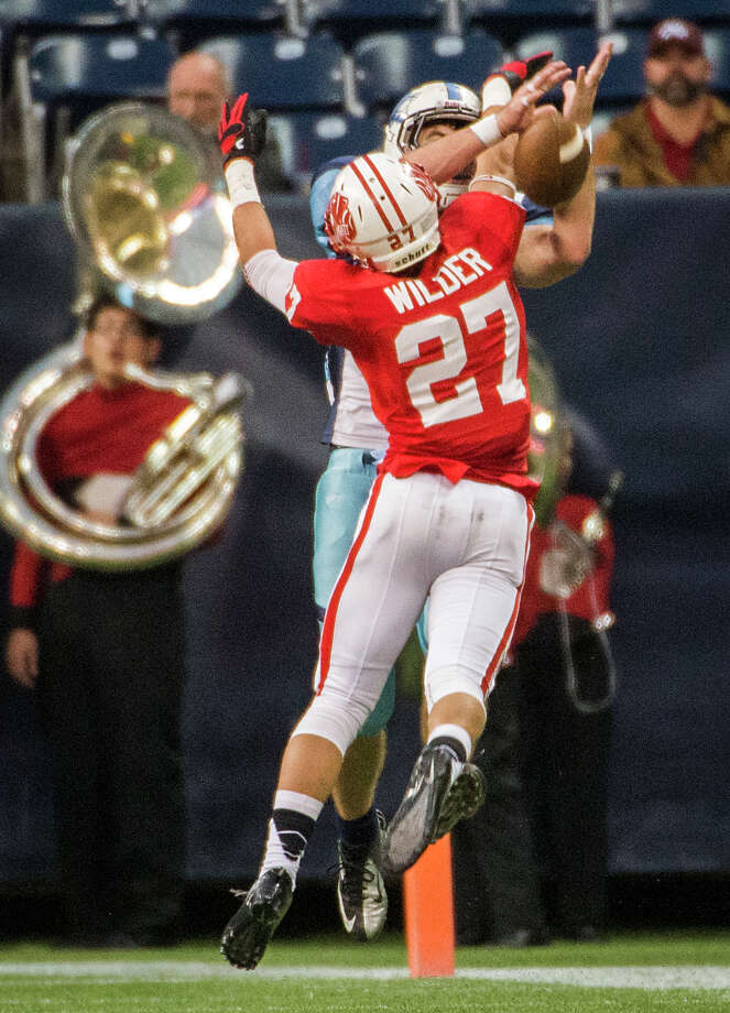 Katy defensive back Collin Wilder (27) breaks up a pass intended for Johnson tight end Devlin Gilligan (84) during the first half of a Class 5A state semifinal high school football playoff game at Reliant Stadium on Saturday, Dec. 14, 2013, in Houston. Photo: Smiley N. Pool, Houston Chronicle / © 2013  Houston Chronicle