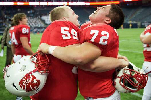 Katy offensive linesman Ty Gipson (59) celebrates with offensive linesman Jeffrey Rodriguez (72) after a victory over San Antonio Johnson in a Class 5A state semifinal high school football playoff game at Reliant Stadium on Saturday, Dec. 14, 2013, in Houston. Katy won the game 52-0. Photo: Smiley N. Pool, Houston Chronicle / © 2013  Houston Chronicle