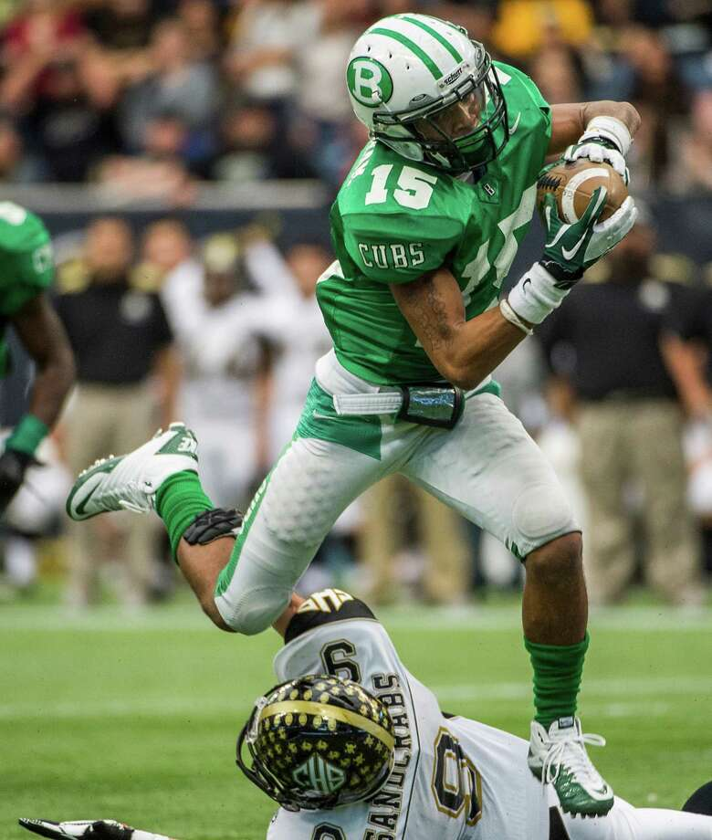 Brenham defensive back Desmond Lockett (15) leaps over Calhoun running back Brandon Smithwick (9) as recovers a fumble and returns if for a touchdown during the first half of a class 4A state semifinal high school football playoff game at Reliant Stadium on Saturday, Dec. 14, 2013, in Houston. Photo: Smiley N. Pool, Houston Chronicle / © 2013  Houston Chronicle