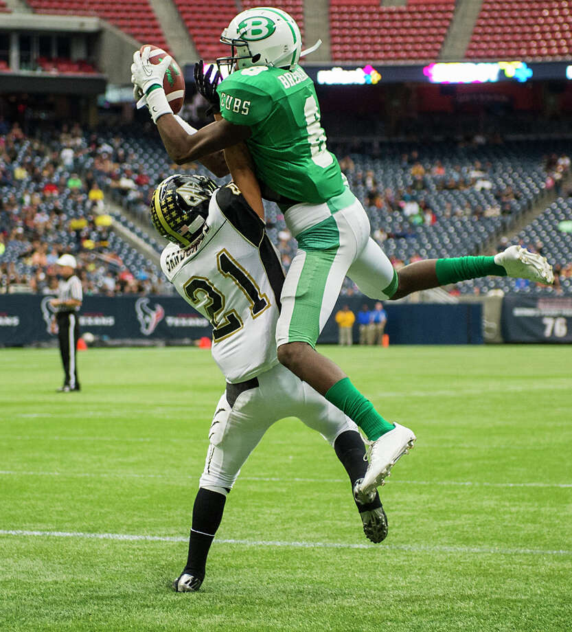 Brenham wide receiver TreVonte Johnson (8) catches a touchdown pass over Calhoun defensive back Mauro Garcia (21) during the first half of a class 4A state semifinal high school football playoff game at Reliant Stadium on Saturday, Dec. 14, 2013, in Houston. Photo: Smiley N. Pool, Houston Chronicle / © 2013  Houston Chronicle