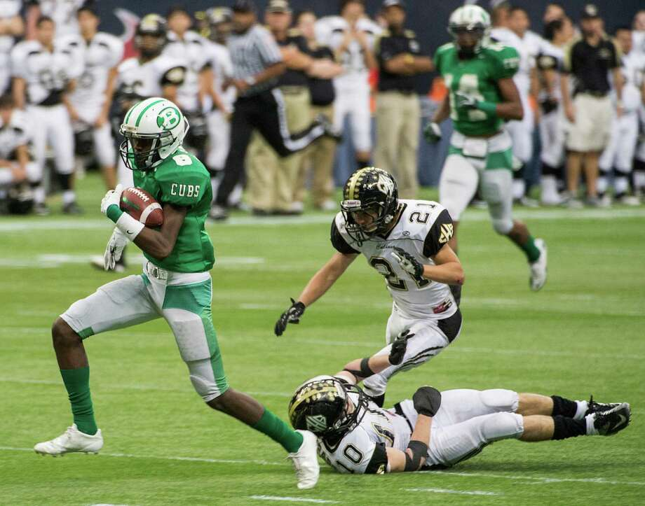 Brenham wide receiver TreVonte Johnson (8) gets past Calhoun defensive backs Taylor Lee (10) and Mauro Garcia (21) on a 61-yard touchdown receptionduring the second half of a class 4A state semifinal high school football playoff game at Reliant Stadium on Saturday, Dec. 14, 2013, in Houston.  Brenham won the game 56-21. Photo: Smiley N. Pool, Houston Chronicle / © 2013  Houston Chronicle