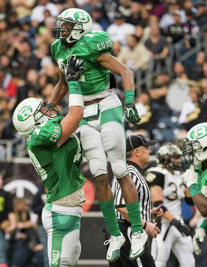 Brenham wide receiver Courtland Sutton (14) celebrates with offensive tackle Austin Schlottman (70) after scoring on a 35-yard touchdown reception during the second half of a class 4A state semifinal high school football playoff game against Calhoun at Reliant Stadium on Saturday, Dec. 14, 2013, in Houston.  Brenham won the game 56-21. Photo: Smiley N. Pool, Houston Chronicle / © 2013  Houston Chronicle