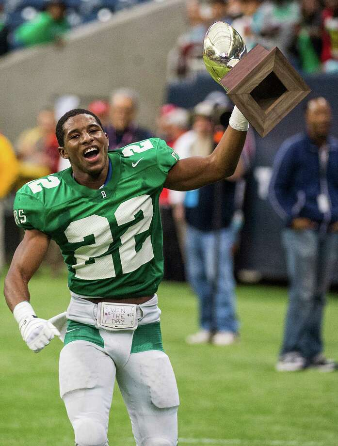 Brenham running back Ryan Nunn (22) runs with the state semifinal championship trophy after a victory over Calhoun in class 4A high school football playoff game at Reliant Stadium on Saturday, Dec. 14, 2013, in Houston. Photo: Smiley N. Pool, Houston Chronicle / © 2013  Houston Chronicle
