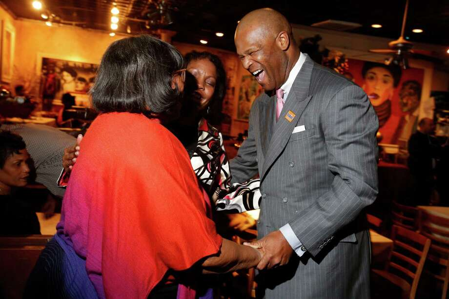 Lobbyist Dwight Boykins, greeting supporters Saturday at Club 4212, won his runoff for Houston City Council District D. Photo: Eric Kayne / Eric Kayne