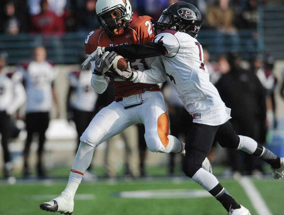 San Antonio Madison wide receiver Ja'Michael Brown catches a first-half touchdown pass as Pearland defensive back Caleb Farris attempts to make a play during Class 5A Division I state semifinal game action at Waco ISD Stadium on Saturday, Dec. 14, 2013. Photo: Billy Calzada, San Antonio Express-News / San Antonio Express-News