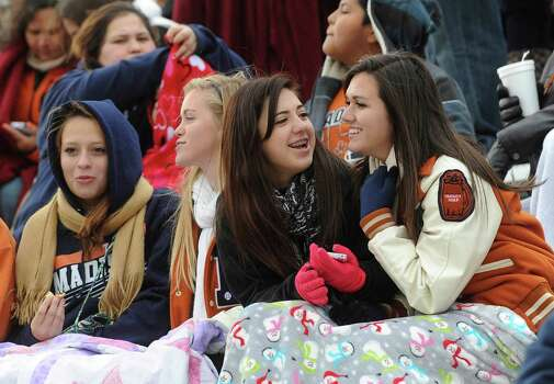Madison fans brave the cold to support their team against Pearland in Class 5A Division I state semifinal football action at Waco ISD Stadium on Saturday, Dec. 14, 2013. Photo: Billy Calzada, San Antonio Express-News / San Antonio Express-News