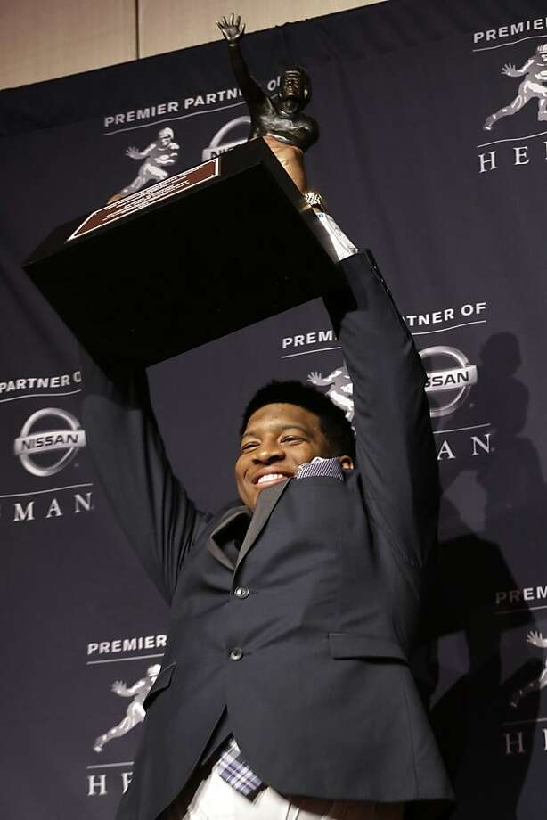 Jameis Winston is the nation's top-rated passer, having led Florida State to a 13-0 record and the national title game. Photo: Julio Cortez, Associated Press