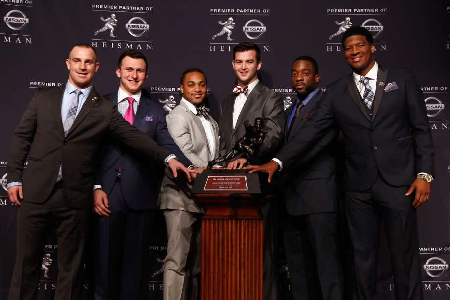 December 14, 2013 -- For the second straight season, Manziel is named a finalist for the Heisman Trophy. Florida State quarterback Jameis Winston (far right) wins the award. Photo: Jeff Zelevansky, Getty Images