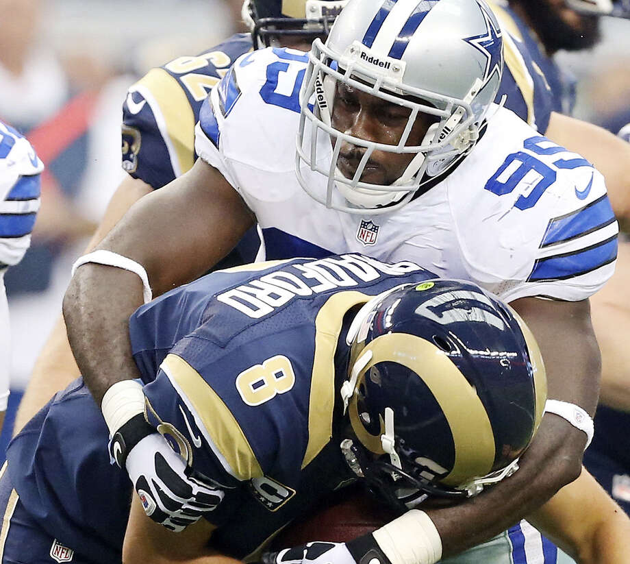 Cowboys defensive end George Selvie, sacking the Rams' Sam Bradford earlier this season, has only one sack in the past six games. Photo: Edward A. Ornelas / San Antonio Express-News / © 2012 San Antonio Express-News