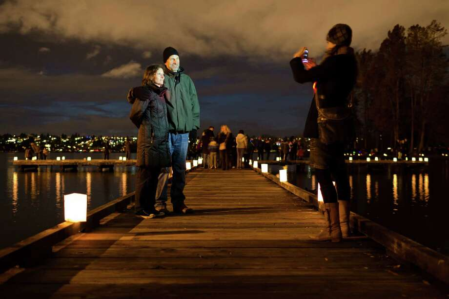 Families and friends travelled the 2.8-mile loop of the annual Green Lake Pathway of Lights, taking in the glow of the luminaria Saturday, Dec. 14, 2013, in Seattle. Photo: JORDAN STEAD, SEATTLEPI.COM / SEATTLEPI.COM