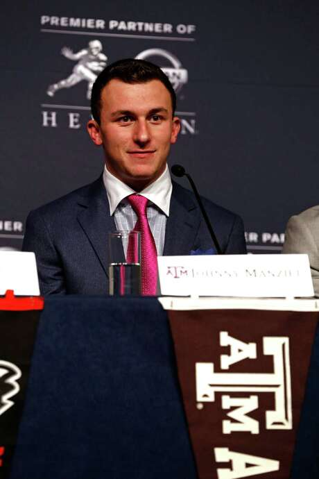 NEW YORK, NY - DECEMBER 14:  Heisman Trophy finalist Johnny Manziel, quarterback of the Texas A&M Aggies, speaks to the media during a press conference prior to the 2013 Heisman Trophy Presentation at the Marriott Marquis on December 14, 2013 in New York City.  (Photo by Jeff Zelevansky/Getty Images) Photo: Jeff Zelevansky, Stringer / 2013 Getty Images