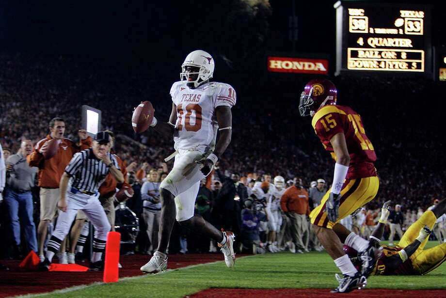 Jan. 4, 2006 — Vince Young's fourth-down, 9-yard dash capped the Longhorns' national title run.PHOTO: Young scores a last-minute, game-winning touchdown in front of USC player Kevin Thomas in the second half of the Rose Bowl at Rose Bowl Stadium in Pasadena. Photo: BAHRAM MARK SOBHANI, San Antonio Express-News / © San Antonio Express-News