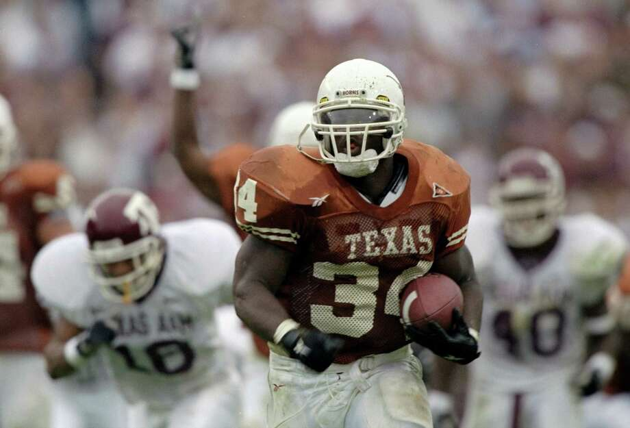 Nov. 27, 1998 — It's easy to remember this was the game when Ricky Williams rushed for 259 yards and broke Tony Dorsett's career NCAA rushing record. But UT blew a 23-7 lead and trailed 24-23 with 2:20 remaining. Major Applewhite's drive to set up Justin Stockton's 24-yard field goal beat eventual Big 12 champions. PHOTO: Williams in action against the Aggies at the Memorial Stadium in Austin. Photo: Brian Bahr, Getty Images / Getty Images North America