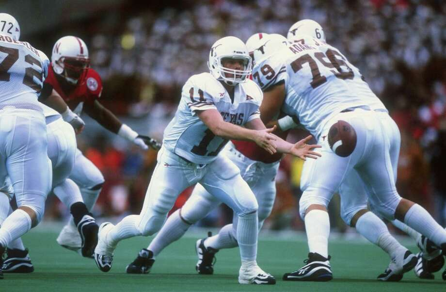 Oct. 31, 1998— Mack Brown's first signature win ended the Cornhuskers' 47-game home winning streak and put Ricky Williams on the road to the Heisman Trophy. Clark grad Wane McGarity caught the winning TD pass from Major Applewhite with 2:47 left. PHOTO:  Applewhite in action against the Nebraska Cornhuskers at the Memorial Stadium in Lincoln, Neb. Photo: Brian Bahr, Getty Images / Getty Images North America
