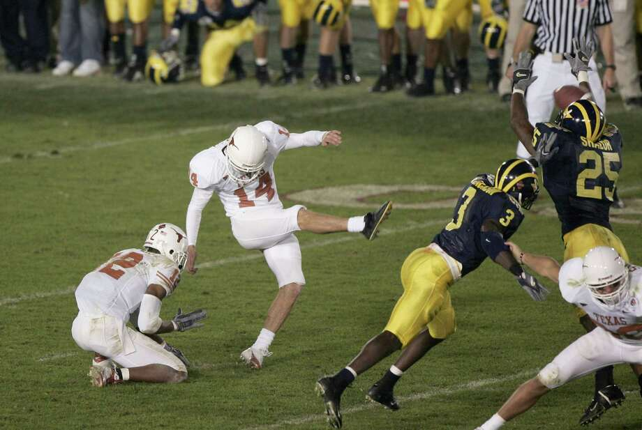 Jan. 1, 2005— Dusty Mangum's final second 37-yard field goal at the Rose Bowl set up UT's national title run the next season.  PHOTO:  Mangum kicks the game-winning field goal against the Wolverines in the 91st Rose Bowl Game at the Rose Bowl in Pasadena, Calif. Photo: Jed Jacobsohn, Getty Images / 2005 Getty Images