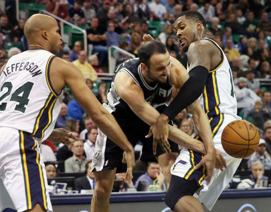 San Antonio Spurs' Manu Ginobili, center, bobbles the ball as Utah Jazz's Richard Jefferson (24) and Derrick Favors, right, put on the pressure in the first half of an NBA basketball game on Saturday, Dec. 14, 2013, in Salt Lake City. (AP Photo/Kim Raff) Photo: Associated Press
