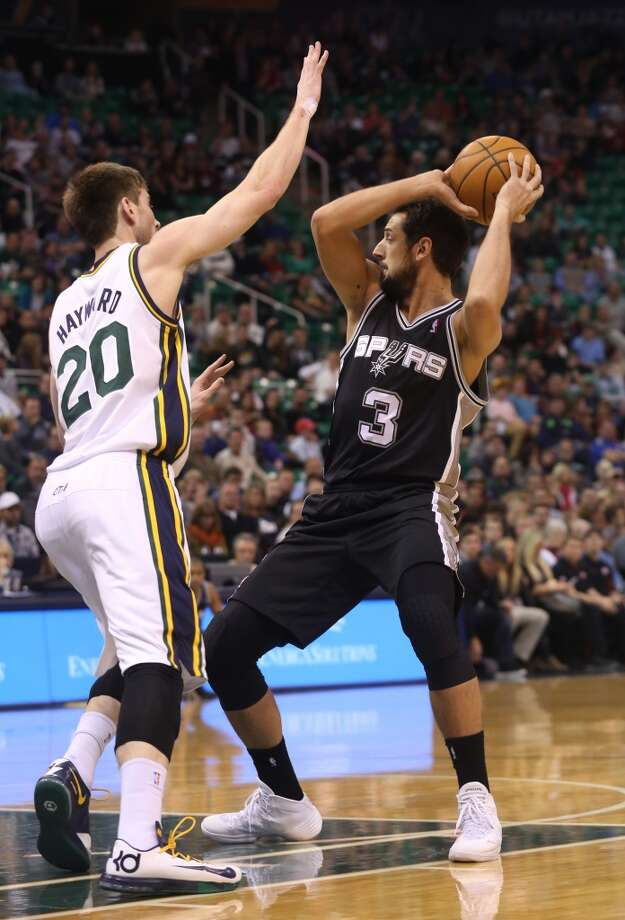 San Antonio Spurs' Marco Belinelli (3) looks to pass the ball as Utah Jazz's Gordon Hayward (20) defends in the first half of an NBA basketball game on Saturday, Dec. 14, 2013, in Salt Lake City. (AP Photo/Kim Raff) Photo: Kim Raff, Associated Press