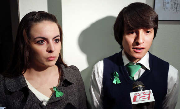 University of the Incarnate Word students Miriam Thomas, 20, (left) and Jonathan Guajardo, 22, answer questions from the media, Monday Dec. 9, 2013, after a press conference on the shooting death, by a campus officer Friday, of their friend Robert Cameron Redus, 23,. Photo: San Antonio Express-News / © 2013 San Antonio Express-News