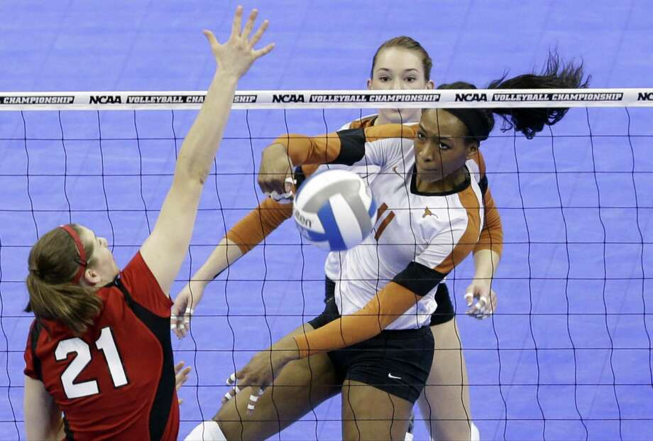 Texas' Chiaka Ogbogu has a kill as Nebraska's Melanie Keil defends at the NCAA regional in Lincoln, Neb. Texas won to advance to the Final Four. Photo: Nati Harnik / Associated Press / AP