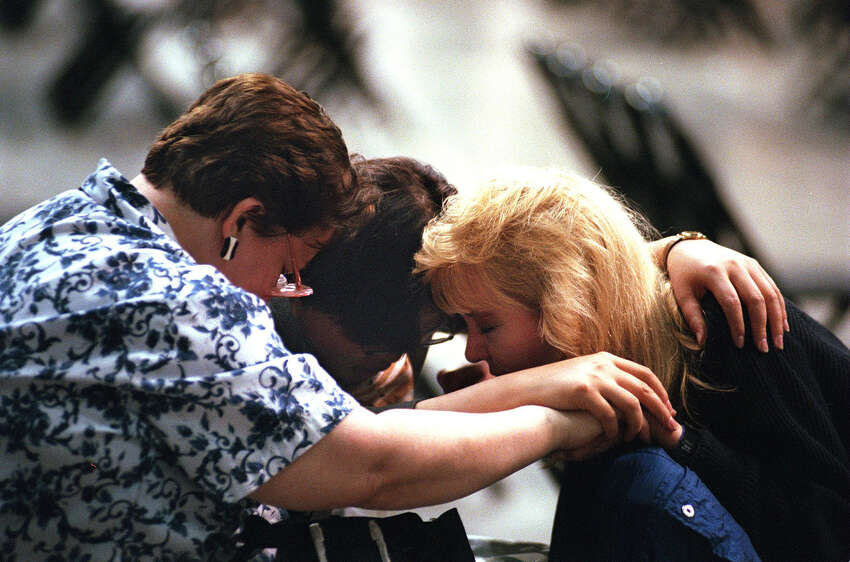 Counselors Linda Nickens (from left), Sun Hee Lien and Jenny Darnell huddle together in prayer before the start of the first service of the Billy Graham Crusade in San Antonio on Thursday, April 3, 1997.