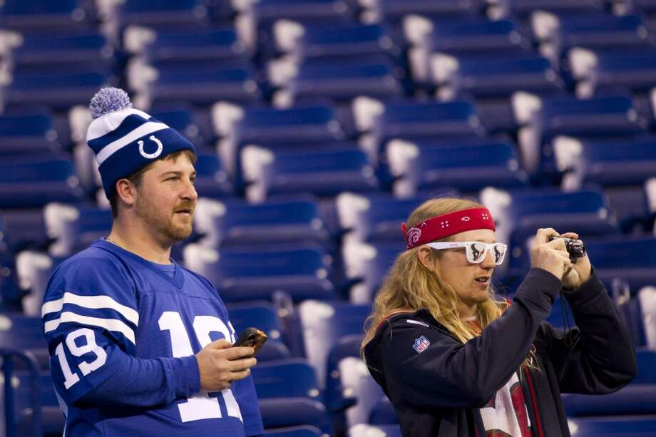 A Texans fan and Colts fan watch warmups before the game. Photo: Brett Coomer, Houston Chronicle