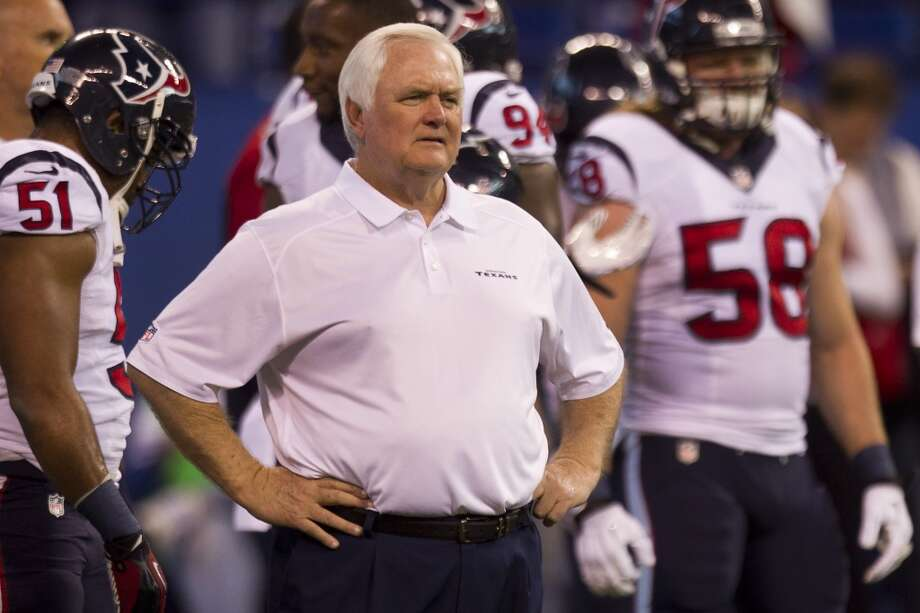 Texans interim head coach Wade Phillips watches his team warm up before their game against the Colts. Photo: Brett Coomer, Houston Chronicle