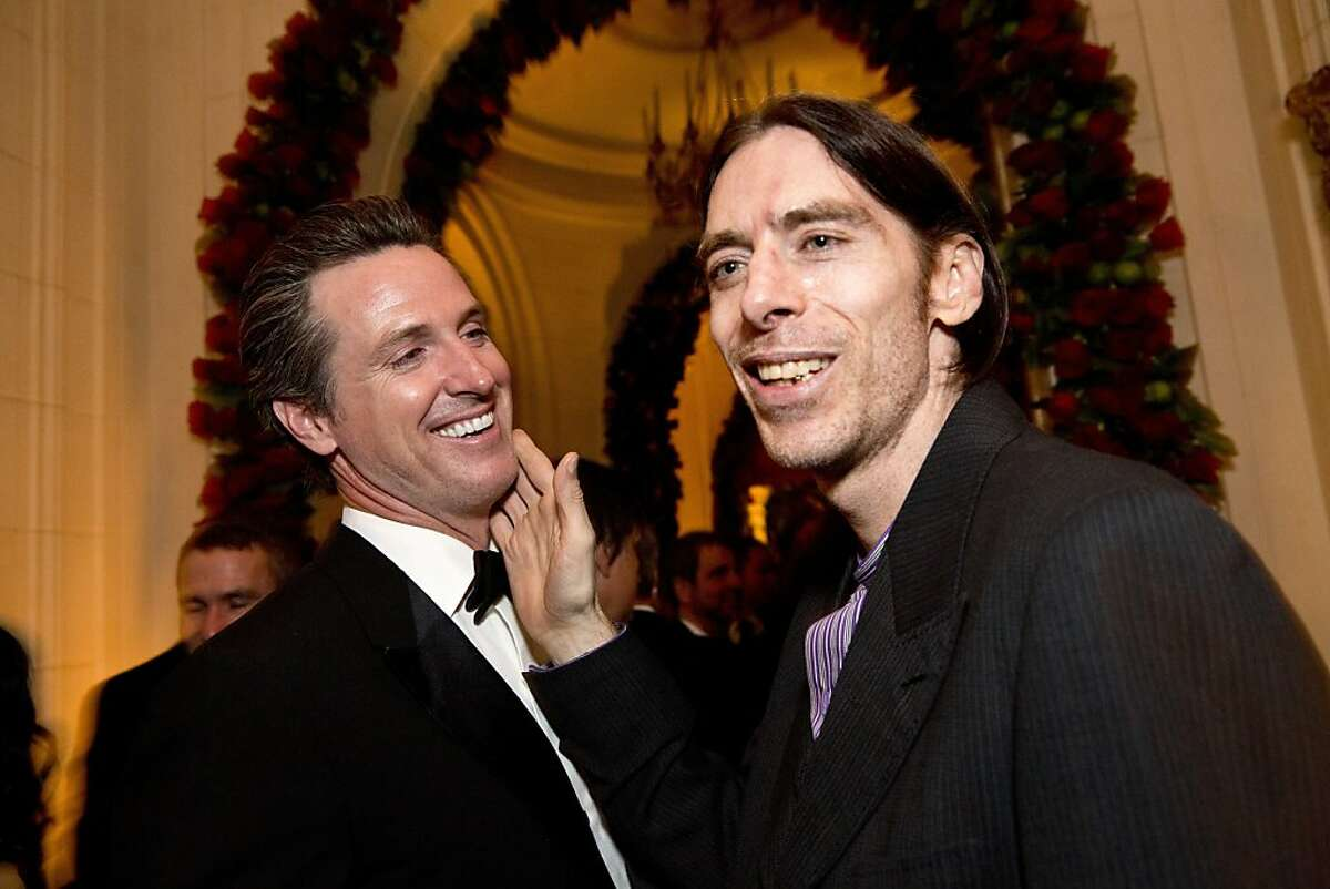 Now-California Governor Gavin Newsom (left) talks with John Getty during Gordon Getty's 80th birthday party at the Getty's home in Pacific Heights in San Francisco, Calif., on Saturday, December 14, 2013.