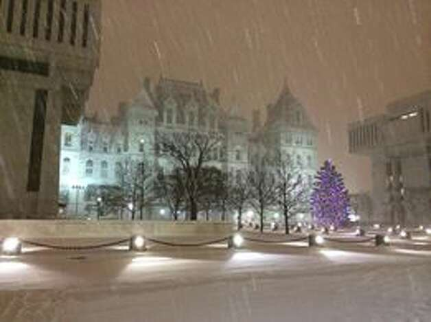 Photo provided by reader Burton Phillips of snowfall at Empire Plaza Dec. 14, 2013 around 10:30 p.m. (Facebook)