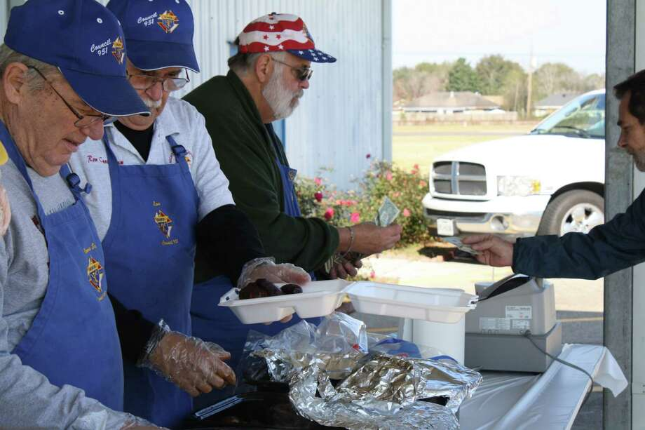 Knights of Columbus members were out Sunday selling barbecue plates for the Beaumont Enterprise Empty Stocking Fund. Monetary donations for the Empty Stocking Fund are still being collected and will be used to pay for this year s toys, as well as toys for next year. Donations can be mailed in or visit the newspaper s offices at 380 Main Street downtown from 9 a.m. to 3 p.m. to personally drop your donation   large or small   to Marie Richard in the lobby. For questions about the Empty Stocking Fund, contact 409-880-0705. Photo: Jose D. Enriquez III