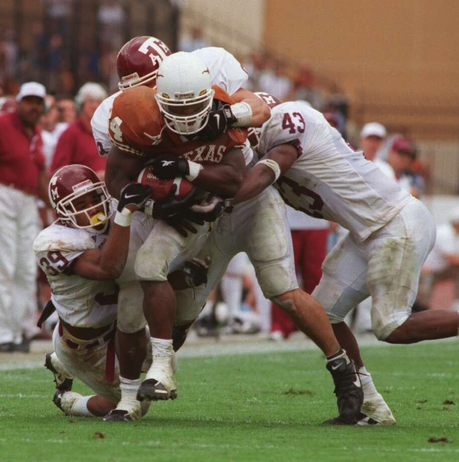 Texas 26, No. 6 Texas A&M 24 Nov. 27, 1998  Brown's first win over rival Aggies also is the game where Williams breaks the NCAA career rushing record. Photo: Kerwin Plevka, Houston Chronicle