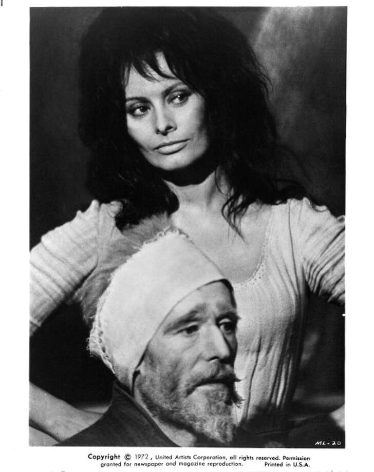 Peter O'Toole with a cloth tied around his forehead and Sophia Loren standing with her hands on her hips in a scene from the film 'Man Of La Mancha', 1972. (Photo by United Artists/Getty Images) Photo: Michael Ochs Archives, Getty Images / 2013 Getty Images