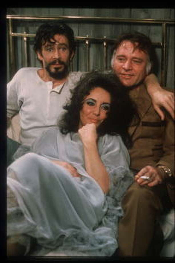"Actors Elizabeth Taylor, Peter O''Toole and Richard Burton sit together on the set of ""Under Milk Wood"" October 15, 1972 in USA. Taylor won Best Actress Oscars for both ""Butterfield 8"" and ""Who's Afraid of Virginia Woolf"" before floundering in the 1970's with a string of unusual and unsuccessful films. (Photo by Forum/Liaison) Photo: Forum, Getty Images / Hulton Archive"