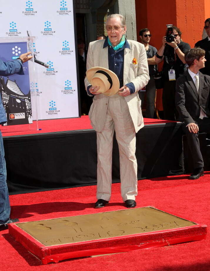 Actor Peter O'Toole speaks during a Hand and Footprints Ceremony presented by the TCM Classic Film Festival at Grauman's Chinese Theater on April 30, 2011 in Hollywood, California.  (Photo by Frederick M. Brown/Getty Images) Photo: Frederick M. Brown, Getty Images / 2011 Getty Images