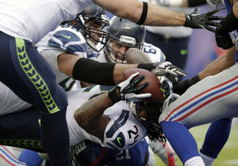 Seattle Seahawks running back Marshawn Lynch (24) dives in for a touchdown against the New York Giants during the first half of an NFL football game, Sunday, Dec. 15, 2013, in East Rutherford, N.J. (AP Photo/Kathy Willens) Photo: Kathy Willens, AP