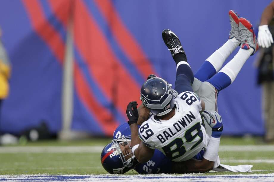 Seattle Seahawks wide receiver Doug Baldwin (89) is tackled by New York Giants cornerback Terrell Thomas (24) during the first half of an NFL football game, Sunday, Dec. 15, 2013, in East Rutherford, N.J. (AP Photo/Kathy Willens) Photo: Kathy Willens, AP
