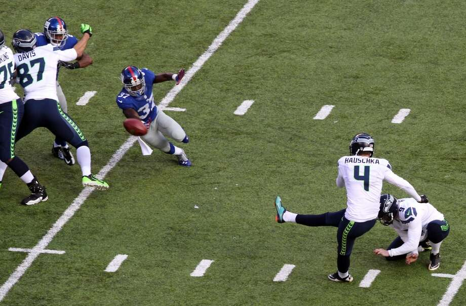 Seattle Seahawks kicker Steven Hauschka (4), with Jon Ryan holding, kicks a field goal against the New York Giants during the first half of an NFL football game, Sunday, Dec. 15, 2013, in East Rutherford, N.J. (AP Photo/Peter Morgan) Photo: Peter Morgan, AP